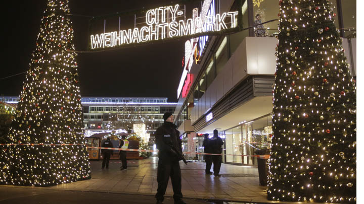 Police guard a Christmas market after a truck ran into a crowded Christmas market and killed several people in Berlin, Germany, Monday, Dec. 19, 2016. Markus Schreiber/AP