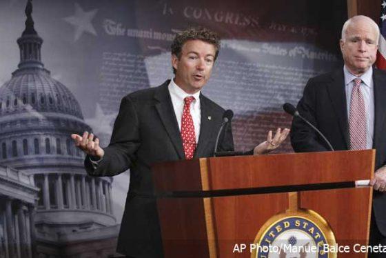 Sen.-Rand-Paul,-R-Ky.,-left,-accompanied-by-Sen.-John-McCain,-R-Ariz