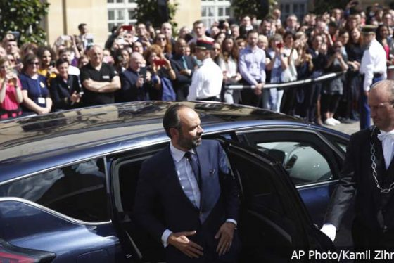 Newly appointed French Prime Minister Edouard Philippe gets out of his car prior to his meeting with outgoing Prime Minister, Bernard Cazeneuve, in Paris, France, Monday, May 15, 2017. On his first full day in office, French President Emmanuel Macron moved quickly Monday on fronts both foreign and domestic, naming 46-year-old lawmaker Edouard Philippe as his new prime minister before flying off to Berlin for talks with Chancellor Angela Merkel. (AP Photo/Kamil Zihnioglu)