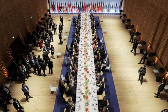 The heads of government of the G-20 states and their partners have dinner after a concert in the Elbphilharmonie concert hall in Hamburg, Germany, Friday, July 7, 2017. (Kay Nietfeld/Pool Photo via AP)