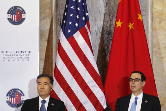 Chinese Vice Premier Wang Yang, left, and Treasury Secretary Steven Mnuchin, attend the U.S.-China Comprehensive Economic Dialogue, Wednesday, July 19, 2017, at the Treasury Department in Washington. (AP Photo/Jacquelyn Martin)