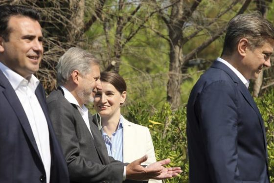 European Union's enlargement commissioner Johannes Hahn, second left, chats with Serbia's Prime minister Ana Brnabic, second right during an an informal meeting of Western Balkans countries in the Albanian port city of Durres, 33 kilometers (20 miles) west of the Tirana. Prime ministers from Western Balkans countries have gathered for an informal meeting to discuss deepening regional economic cooperation as part of the process for joining the European Union. (AP Photo/Hektor Pustina