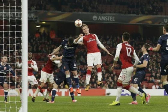 Arsenal's Rob Holding, top, and Red Star's Damien Le Tallec go for a header during a Group H Europa League soccer match between Arsenal London and Red Star Belgrade at the Emirates stadium in London, Britain, Thursday, Nov. 2, 2017. (AP Photo/Tim Ireland)