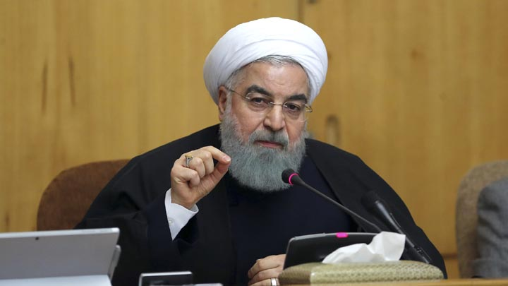 "In this photo released by official website of the office of the Iranian Presidency, President Hassan Rouhani speaks in a cabinet meeting in Tehran, Iran, Sunday, Dec. 31, 2017. After a wave of economic protests swept major cities in Iran, President Rouhnai said Sunday that people have the right to protest, but those demonstrations should not make the public ""feel concerned about their lives and security."" (Iranian Presidency Office via AP)"