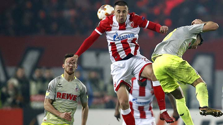 Red Star's Milan Rodic, center, challenges for the ball with Cologne's Milos Jojic, right, during the Europa League group H soccer match between Red Star and Cologne on the stadium Rajko Mitic in Belgrade, Serbia, Thursday, Dec. 7, 2017. (AP Photo/Darko Vojinovic)