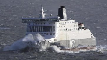 The DFDS Dover Seaways passenger ferry is engulfed by waves in heavy weather as she approaches the Port of Dover, southern England, Wednesday Jan. 3, 2018.  A severe storm packing winds of up to 100 miles per hour has battered much of Europe overnight and Wednesday morning, bringing heavy rain, hail and lightning to the region and leaving some thousands of homes without power. (Gareth Fuller/PA via AP)