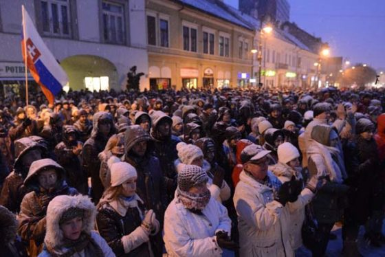 People gather to commemorate murdered journalist Jan Kuciak and his fiancee, and call for a proper investigation of the case, in Kosice, Slovakia, Friday evening March 2, 2018. Seven men were detained Thursday as suspects during police raids in the eastern Slovak towns of Michalovce and Trebisov, said national police chief Tibor Gaspar. (Milan Kapusta/TASR via AP)
