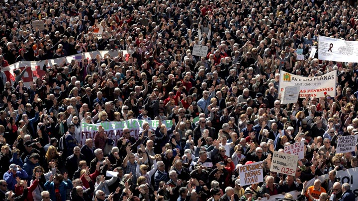 People march during a protest by pensioners in Barcelona, Spain, Saturday, March 17, 2018. Tens of thousands of elderly Spaniards rallied across the country Saturday to demand an increase in public pension payouts. (AP Photo/Manu Fernandez)