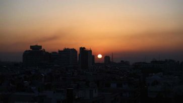 The sun sets as smoke rises after airstrikes targeting different parts of the Syrian capital Damascus, early Saturday, April 14, 2018. Syria's capital has been rocked by loud explosions that lit up the sky with heavy smoke as U.S. President Donald Trump announced airstrikes in retaliation for the country's alleged use of chemical weapons. (AP Photo/Hassan Ammar)