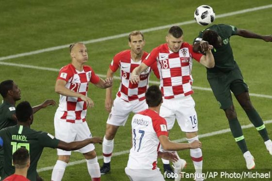 Nigeria players (green) and Croatia players jump for the ball during the group D match between Croatia and Nigeria at the 2018 soccer World Cup in the Kaliningrad Stadium in Kaliningrad, Russia, Saturday, June 16, 2018. (AP Photo/Michael Sohn)