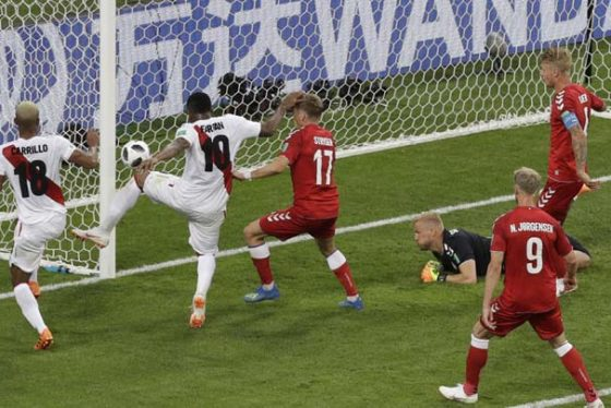 Peru's Jefferson Farfan, second from left, fails to score as Denmark goalkeeper Kasper Schmeichel looks on during the group C match between Peru and Denmark at the 2018 soccer World Cup in the Mordovia Arena in Saransk, Russia, Saturday, June 16, 2018. (AP Photo/Gregorio Borgia)