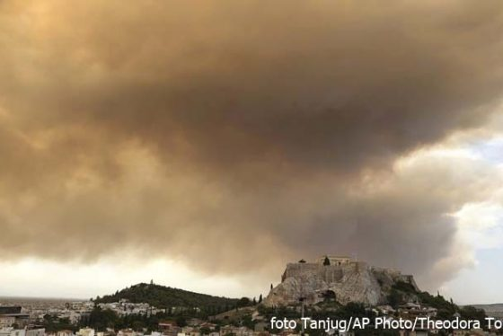 A fire burning a pine forest in a mountainous area west of Athens has sent nearby residents fleeing, with smoke from the blaze turning much of the sky over the Greek capital orang on Monday, July 23, 2018. The fire department said five water-dropping planes and two helicopters were battling the blaze Monday in the Geraneia mountains near the seaside settlement of Kineta between Athens and Corinth, along with 30 firetrucks and 70 firefighters. The ancient Acropolis hill is seen in foreground. (AP Photo/Theodora Tongas)