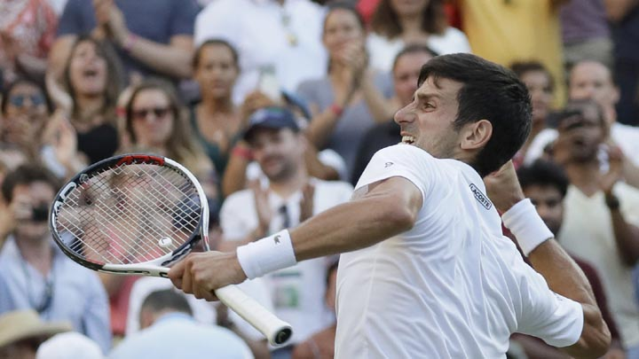 Serbia's Novak Djokovic celebrates winning his men's singles match against Kyle Edmund of Great Britain, on the sixth day of the Wimbledon Tennis Championships in London, Saturday July 7, 2018. (AP Photo/Kirsty Wigglesworth)