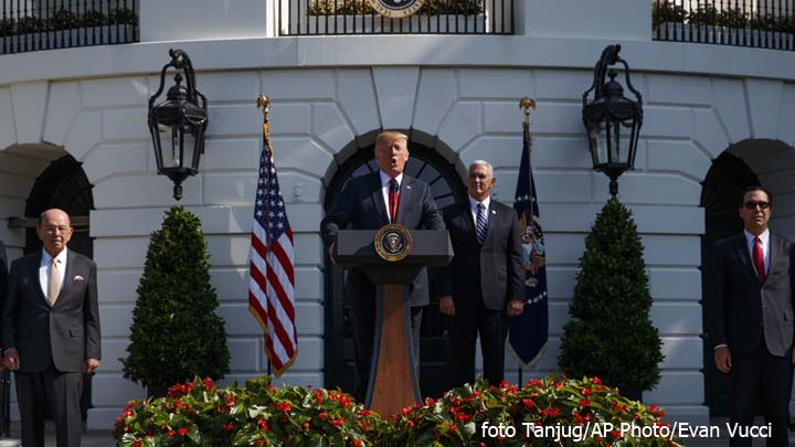 President Donald Trump delivers remarks about the economy on the South Lawn of the White House, Friday, July 27, 2018