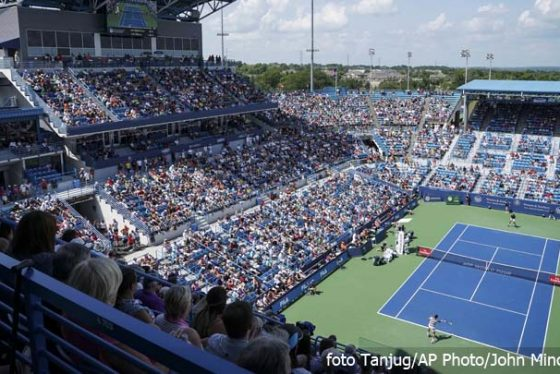 Marin Cilic, of Croatia, returns to Novak Djokovic, of Serbia, in a semi-final match at the Western & Southern Open tennis tournament, Saturday, Aug. 18, 2018, in Mason, Ohio. (AP Photo/John Minchillo)