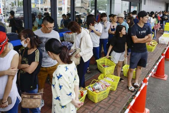 People wait in a long line to buy foods at a store in Sapporo, Hokkaido, northern Japan Thursday, Sept. 6, 2018. Rescuers were rushing to unearth survivors and restore power Thursday after a powerful earthquake jolted Japan's northernmost main island of Hokkaido, buckling roads, knocking homes off their foundations and causing entire hillsides to collapse. (Hiroki Yamauchi/Kyodo News via AP)