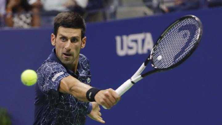 Novak Djokovic, of Serbia, hits a backhand to John Millman, of Australia, during the quarterfinals of the U.S. Open tennis tournament Wednesday, Sept. 5, 2018, in New York. (AP Photo/Frank Franklin II)