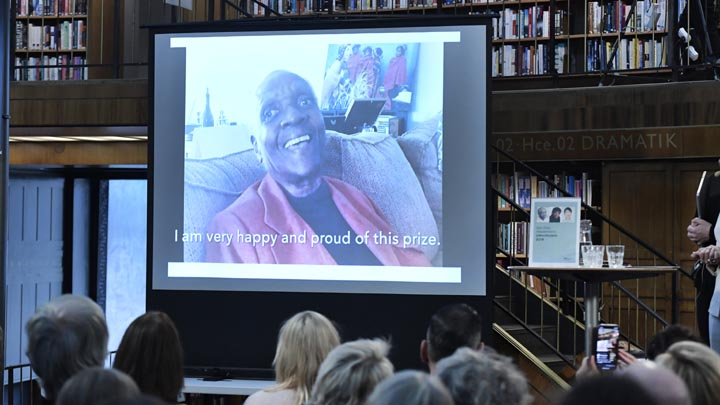 Maryse Conde, an author from Guadeloupe living in Paris, appears via videolink after she was awarded the Alternative Nobel Literature Prize, in Stockholm City Library, Stockholm, Friday, Oct. 12, 2018. (Janerik Henriksson/TT News Agency via AP)