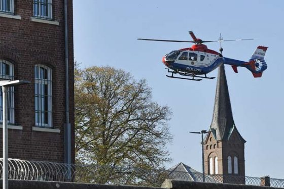 A helicopter deports takes off from the prison in Hamburg, Germany, Monday, Oct. 15, 2018.  Authorities did not confirm that terrorist Mounir el-Motassadeq was transported to the airport to be deported to Morocco after he was sentenced to the maximum 15 years in 2006 for supporting the Sept. 11 attackers. (AP Photo/Martin Meissner)