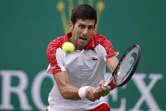 Novak Djokovic of Serbia hits a return shot to Kevin Anderson of South Africa during their men's singles quarterfinals match in the Shanghai Masters tennis tournament at Qizhong Forest Sports City Tennis Center in Shanghai, China, Friday, Oct. 12, 2018. (AP Photo/Andy Wong)