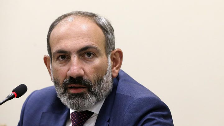 FILE - In this file photo from May 9, 2018, Armenian Prime Minister Nikol Pashinian speaks during a news conference in the capital of Nagorno-Karabakh, a region of Azerbaijan under the control of ethnic Armenian forces. Pashinian stepped down as prime minister on Oct. 16, 2018, in a political maneuver aimed at forcing an early election. (AP Photo/Thanassis Stavrakis, File)