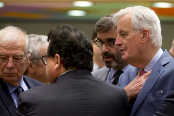EU chief Brexit negotiator Michel Barnier, right, speaks with Spain's Minister of Foreign Affairs Josep Borrell, left, during a meeting of EU General Affairs ministers, Article 50, at the Europa building in Brussels on Monday, Nov. 19, 2018. (AP Photo/Virginia Mayo)