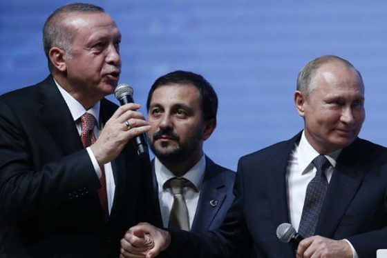 Turkey's President Recep Tayyip Erdogan, left, and Russian President Vladimir Putin, right, hold hands as they attend an event marking the completion of one of the phases of the Turkish Stream natural gas pipeline, in Istanbul, Monday, Nov. 19, 2018. The two 930-kilometer (578-mile) lines when finished are expected to carry 31.5 billion cubic meters (1.1 trillion cubic feet) of Russian natural gas annually to European markets, through Turkish territories. (AP Photo/Lefteris Pitarakis)