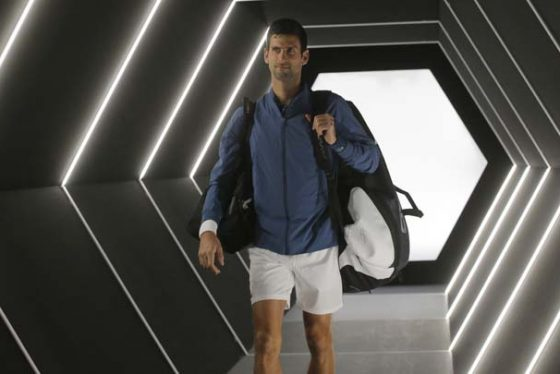 Novak Djokovic of Serbia arrives to play Marin Cilic of Croatia during their quarterfinal match of the Paris Masters tennis tournament at the Bercy Arena in Paris, France, Friday, Nov. 2, 2018. (AP Photo/Michel Euler)