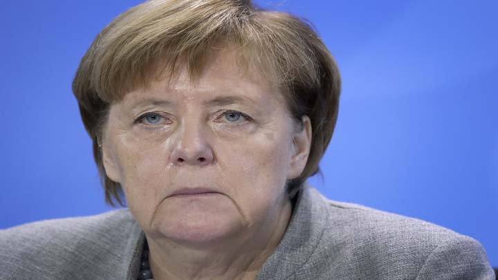 German Chancellor Angela Merkel attends a press conference at the chancellery in Berlin, Germany, Monday, Dec. 3, 2018 after a meeting with representatives of German cities that are affected by nitrogen oxide limit violations. (AP Photo/Michael Sohn)